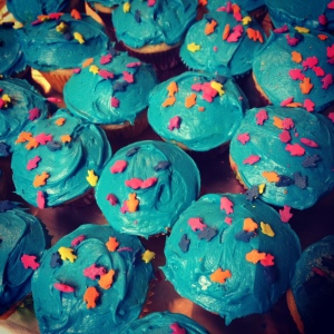 Since we were having an under the sea themed party her class got these totally naturally blue cupcakes with fish sprinkles.